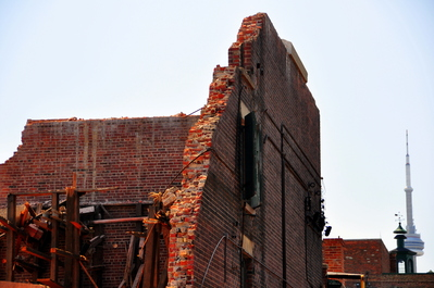 Building in the Distillery District being demolished; ever-present CN Tower in the background