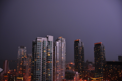 Lightning behind me illuminating the buildings