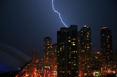 Lightning strike behind the buildings
