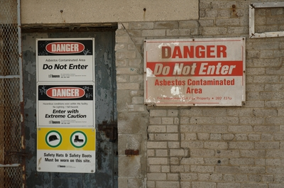 Warning signs against entering the Canada Malting Co. Apparently it's dangerous.