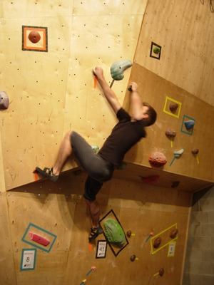 Me slightly further along on a bouldering problem
