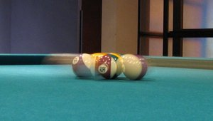 Pool balls being broken apart